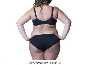 Plus size model in black lingerie, overweight female body, fat woman with cellulitis on buttocks posing isolated on white background, back view