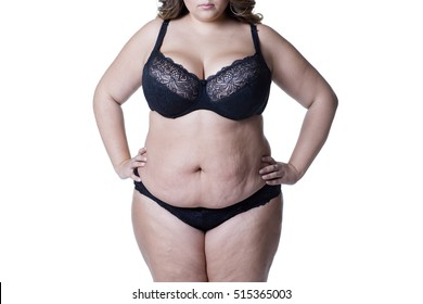 Plus size model in black lingerie, overweight female body, fat woman with stretch marks posing isolated on white background