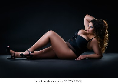 Plus size sexy model in swimsuit, fat woman on black studio background, overweight female body, full length portrait