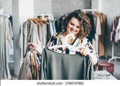 Plus Size Woman Choose Fashioned Dress in Store. Plus size women shopping.