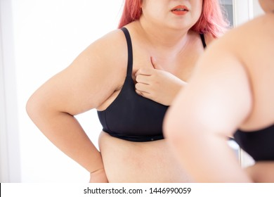 plus size woman do the breast cancer self check