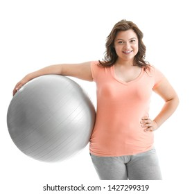 Plus size woman with fitball on white background. Concept of weight loss