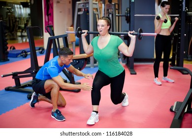 Plus size woman's first training with personal trainer
