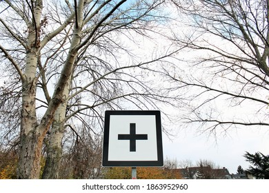 + plus street sign in the nature
