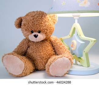 plush bear and night lamp