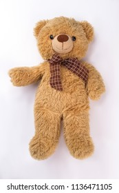 Plush bear toy. White isolated background.