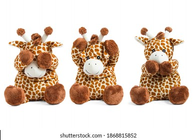 Plush giraffe toy isolated on white background covers eyes, nose and ears colored soft brown toy