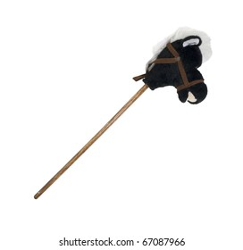 Plush hobby horse with a wooden stick for a body to represent childhood - path included