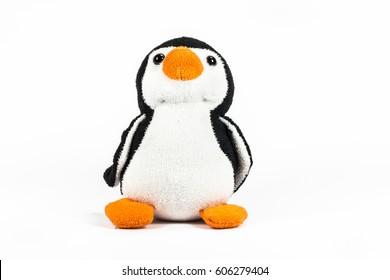 Plush penguin on white background.