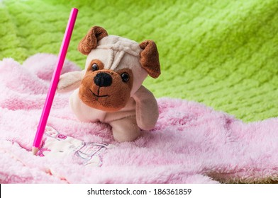 Plush puppy painting little bunny on baby sleepsuits.