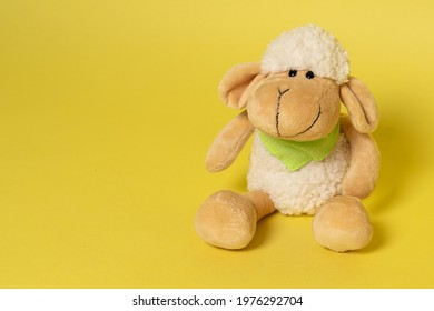 Plush sheep on yellow background