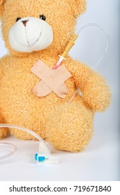 Plush teddy bear with blood transfusion system. Closeup