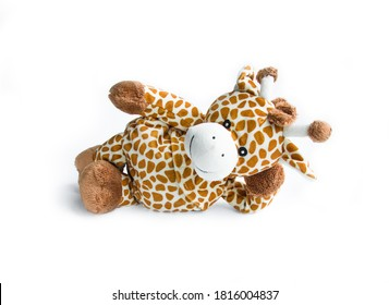 Plush toy giraffe isolated on a white background Colorful plush toy. Colored stuffed toy-giraffe. White and brown giraffe