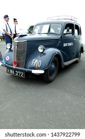 Plymouth Devon England.  Ford  Prefect car in air force blue with Royal Air Force roundel on offside wing. Stamped on door with RAF registration  number. Used as staff car.