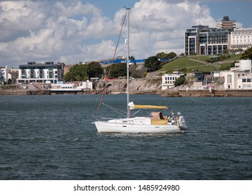 Plymouth Devon UK: August 12th 2019: SCAMANDA Beneteau Oceanis 331 Clipper fast cruising race sailing yacht designed by Group Finot and built by Beneteau of France departing the Port of Plymouth