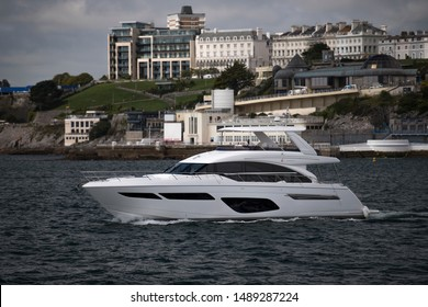 Plymouth Devon UK August 12th 2019 Princess Yachts PRINCESS F70 luxury motor yacht cruiser being put through her paces with the latest Flybridge design and Twin MAN V12-1400 engines in Plymouth Sound