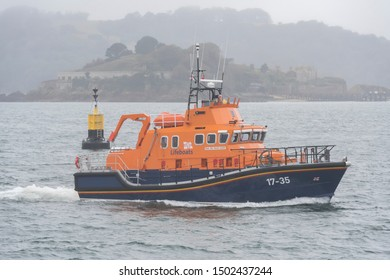 Plymouth Devon UK September 11th 2019 RNLI 17-35 Severn class lifeboat RNLB SYBIL MULLEN GLOVER returning to Port of Plymouth with stricken sister lifeboat RNLI 13-12 RNLB COSANDRA in tow.