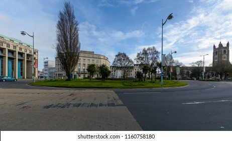 Plymouth, England - April 15, 2018: St Andrews Cross Roundabout with Royal Building in Background