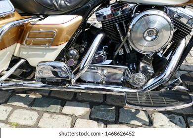Plymouth England August 2019. 1994 Harley- Davidson Electra Glide motorcycle. Concours condition. Gold and cream livery. Highly polished and chromed  covers, exhausts and other aspects.