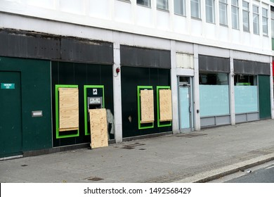 Plymouth England August 2019. Bank closure Lloyds bank city centre branch recently closed. Four outside cash dispensing machines being boarded up. All signage has been removed.
