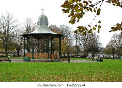 Plymouth England. November 2019. Classic restored circular Victorian Bandstand with wrought iron railings and cast iron pillars supporting a domed curved roof.