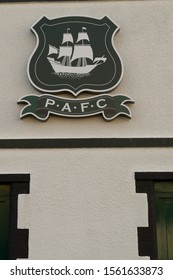 Plymouth England November 2019. Close up of the Coat of Arms of Plymouth Argyle football club at Home Park. Shield with white Elizabethan ship and PAFC thereon. Green background to shield.