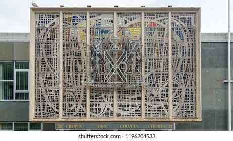 Plymouth, England - Sep 12, 2018: Decorated Panel Above Entrance to Crown and County Courts in Plymouth, Plymouth Combined Court, Shallow Depth of Field