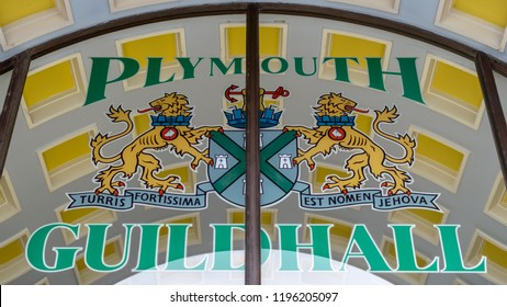 Plymouth, England - Sep 12, 2018: Coat of Arms on Glass above entrance to Plymouth Guildhall, Shallow Depth of Field Mid view