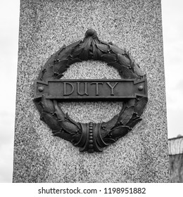 Plymouth, England - Sep 12, 2018: Plymouth City War Memorial Wreath with Duty Plaque, Shallow Depth of Field black and white photography
