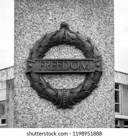 Plymouth, England - Sep 12, 2018: Plymouth City War Memorial Wreath with Freedom Plaque, Shallow Depth of Field black and white photography