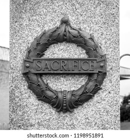 Plymouth, England - Sep 12, 2018: Plymouth City War Memorial Wreath with Sacrifice Plaque, Shallow Depth of Field black and white photography