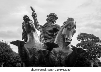 Plymouth, England - Sep 12, 2018: Front view of Neptune Bronze Statue on Plymouth Naval Memorial, Shallow Depth of Field horizontal photography
