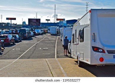 Plymouth, Hampshire / England - 6/1/2017: Cars caravans and motorhomes queuing for cross channel ferry from Portsmouth, UK to St Malo, France