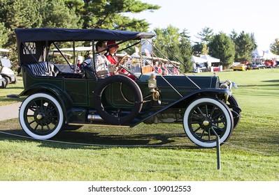 PLYMOUTH - JULY 29 : A gas light class automobile drives by at the Concours D'Elegance  July 29, 2012 in Plymouth, Michigan.