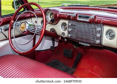 PLYMOUTH, MI/USA - JULY 28, 2019: Closeup of a 1953 Buick Skylark dashboard on display at the Concours d'Elegance of America car show at The Inn at St. John's.