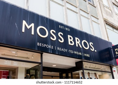 Plymouth, UK. 6/20/18:  The Moss Bros logo above the door of one of its high street shops.