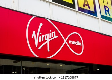 Plymouth, UK. 6/20/18:  The Virgin Media logo above the door of one of its high street shops.