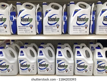 Plymouth, WI USA – SEPTEMBER 18, 2018: Store shelf full of many bottles of Roundup ready to use weed and grass killer. Sprayer and refills.