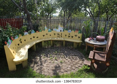 PLYOS, RUSSIAN FEDERATION - AUGUST 24, 2016: Russian dacha in Plyos city (Ivanovo oblast, Russia). Awesome idea for dacha and country house; wooden handicrafts, handmade funny things and bench