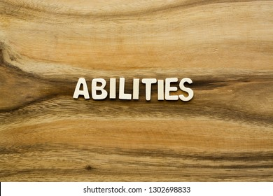 "Plywood alphabets on acacia wooden texture background concept. The word ""ABILITIES"" on wood pattern backdrop."