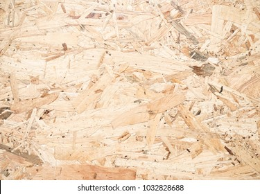 Plywood texture. Pattern of pressed wooden panel background.