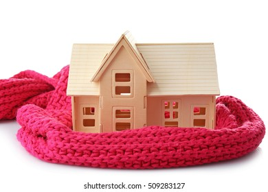 Plywood toy house with warm scarf, isolated on white