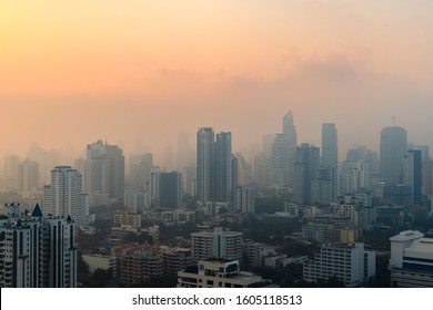 PM 2.5 dust in Bangkok or the center city,Capital city are covered by heavy smog,Misty morning and sunrise in downtown with bad air pollution, the Place to risk of cancer,Thailand-Image
