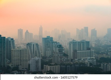 PM 2.5 dust in Bangkok or the city center,Capital city are covered by heavy smog,Misty morning and sunrise in downtown with bad air pollution, the Place to risk of cancer,Thailand-Image