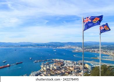 A pnaorama of Gibraltar city with Gibraltar's flags