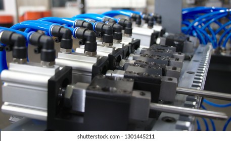 Pneumatic compact air cylinders with air or water elbow fitting connected air or water hoses.Selective focus