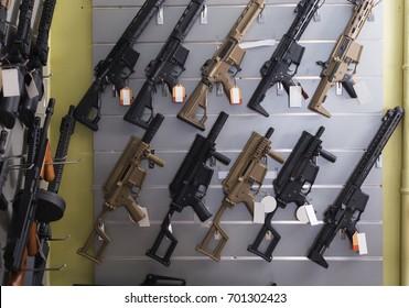 Pneumatic gun hangs on the wall in military shop