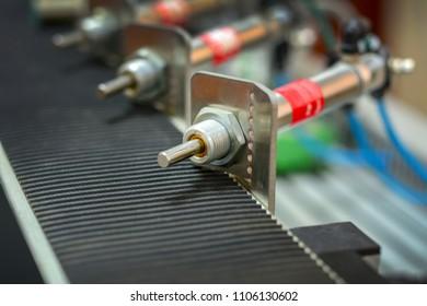 pneumatic piston on the machine, close up