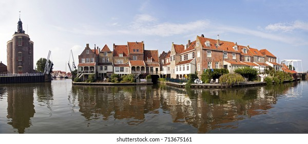 Pnorama photo of Old houses reflecting in the water in the small Dutch harbor town of Enkhuizen