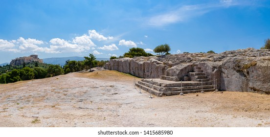 The Pnyx steps, where democracy was born. Panorama with Acropolis hill at the background